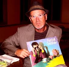 Crenshaw with a copy of his 80s album.